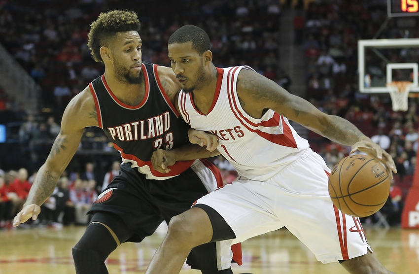 Nov 18, 2015; Houston, TX, USA; Houston Rockets forward Trevor Ariza (1) drives against Portland Trail Blazers forward Allen Crabbe (23) in the first half at Toyota Center. Mandatory Credit: Thomas B. Shea-USA TODAY Sports