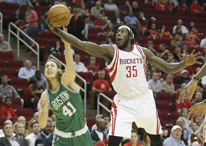 Nov 16, 2015; Houston, TX, USA; Boston Celtics center Kelly Olynyk (41) and Houston Rockets forward Montrezl Harrell (35) reach for a loose ball in the first quarter at Toyota Center. Mandatory Credit: Thomas B. Shea-USA TODAY Sports
