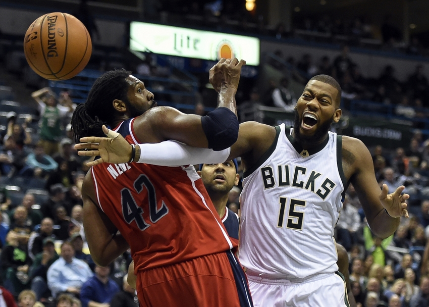 Oct 30, 2015; Milwaukee, WI, USA; Milwaukee Bucks center Greg Monroe (15) and Washington Wizards forward Nene Hilario (42) battles for a rebound in the fourth quarter at BMO Harris Bradley Center. Mandatory Credit: Benny Sieu-USA TODAY Sports