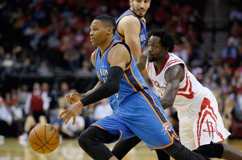 Nov 2, 2015; Houston, TX, USA; Oklahoma City Thunder guard Russell Westbrook (0) dribbles against Houston Rockets guard Patrick Beverley (2) at Toyota Center. Rocket won 110 to 105. Mandatory Credit: Thomas B. Shea-USA TODAY Sports