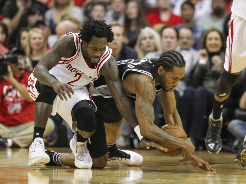 Feb 27, 2016; Houston, TX, USA; Houston Rockets guard Patrick Beverley (2) and San Antonio Spurs forward Kawhi Leonard (2) battle for a loose ball during the second quarter at Toyota Center. Mandatory Credit: Troy Taormina-USA TODAY Sports