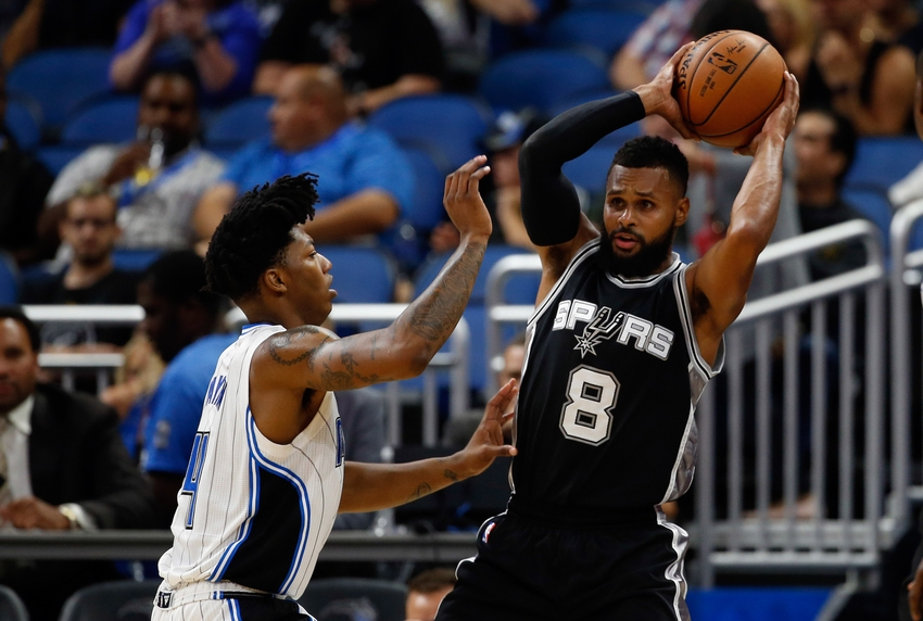 Oct 12, 2016; Orlando, FL, USA; San Antonio Spurs guard Patty Mills (8) passes the ball as Orlando Magic guard Elfrid Payton (4) defends during the first quarter at Amway Center. Mandatory Credit: Kim Klement-USA TODAY Sports