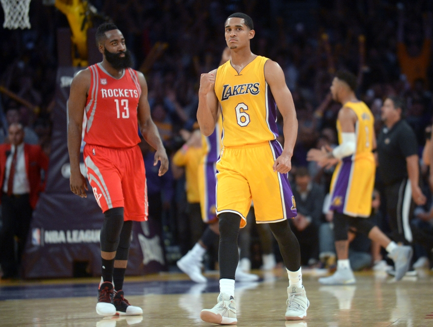 October 26, 2016; Los Angeles, CA, USA; Los Angeles Lakers guard Jordan Clarkson (6) celebrates the 120-114 victroy as Houston Rockets guard James Harden (13) walks off the court following the second half at Staples Center. Mandatory Credit: Gary A. Vasquez-USA TODAY Sports