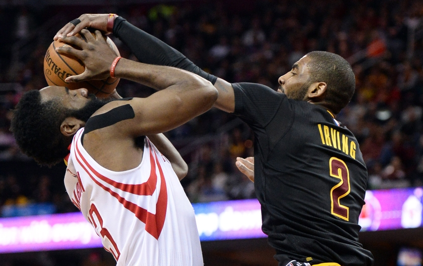 Mar 29, 2016; Cleveland, OH, USA; Cleveland Cavaliers guard Kyrie Irving (2) blocks and steals the ball from Houston Rockets guard James Harden (13) during the first quarter at Quicken Loans Arena. Mandatory Credit: Ken Blaze-USA TODAY Sports