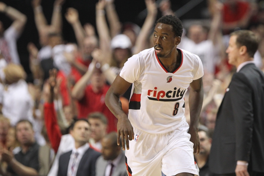 May 7, 2016; Portland, OR, USA; Portland Trail Blazers forward Al-Farouq Aminu (8) reacts after making a three point shot against the Golden State Warriors in game three of the second round of the NBA Playoffs at Moda Center at the Rose Quarter. Mandatory Credit: Jaime Valdez-USA TODAY Sports