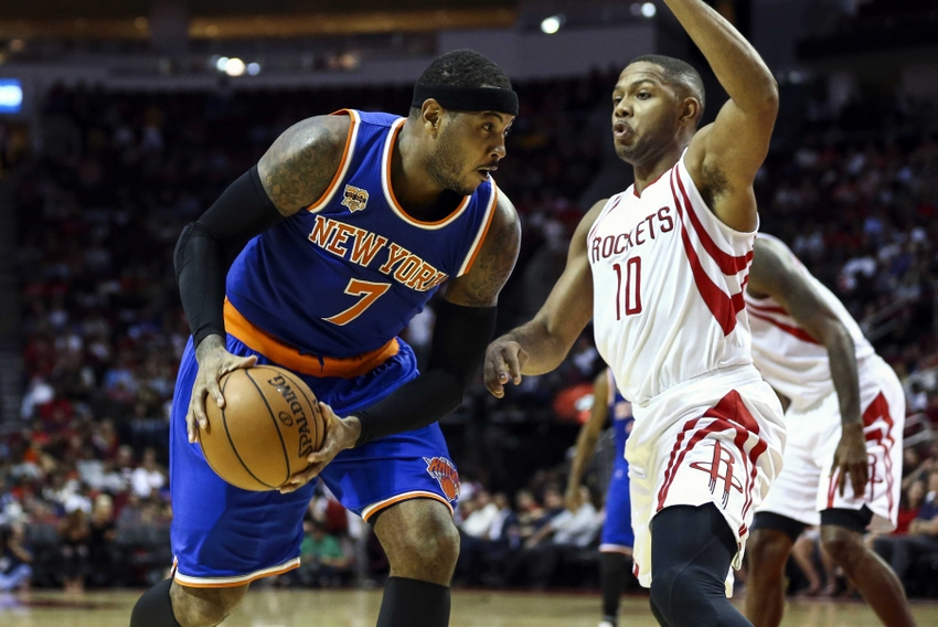 Oct 4, 2016; Houston, TX, USA; New York Knicks forward Carmelo Anthony (7) dribbles the ball as Houston Rockets guard Eric Gordon (10) defends during the third quarter at Toyota Center. The Rockets won 130-103. Mandatory Credit: Troy Taormina-USA TODAY Sports