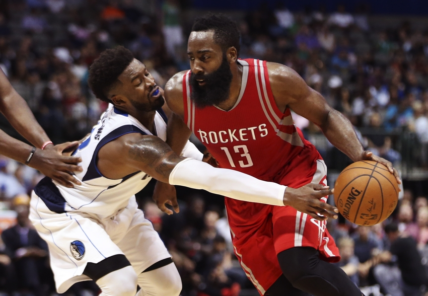 Oct 19, 2016; Dallas, TX, USA; Houston Rockets guard James Harden (13) dribbles as Dallas Mavericks guard Wesley Matthews (left) defends during the second half at American Airlines Center. Mandatory Credit: Kevin Jairaj-USA TODAY Sports