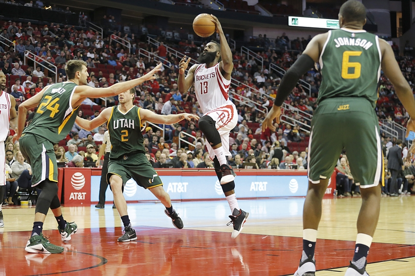 Nov 19, 2016; Houston, TX, USA; Houston Rockets guard James Harden (13) drives to the basket against Utah Jazz center Jeff Withey (24) and forward Joe Ingles (2) in the second half at Toyota Center. Rockets won 111-102. Mandatory Credit: Thomas B. Shea-USA TODAY Sports