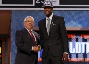 NBA prospect Kidd-Gilchrist from the University of Kentucky shakes hands with NBA Commissioner Stern after being selected by the Charlotte Bobcats as the second overall pick in the 2012 NBA Draft in Newark