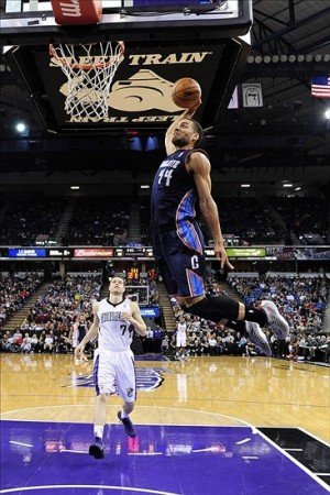 March 3, 2013; Sacramento, CA, USA; Charlotte Bobcats shooting guard Jeffery Taylor (44) dunks the ball in front of Sacramento Kings point guard Jimmer Fredette (7) during the third quarter at Sleep Train Arena. The Kings defeated the Bobcats 119-83. Mandatory Credit: Kyle Terada-USA TODAY Sports