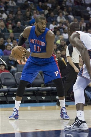 Mar 23, 2013; Charlotte, NC, USA; Detroit Pistons center Greg Monroe (10) holds the ball during the first half against the Charlotte Bobcats at Time Warner Cable Arena. Mandatory Credit: Jeremy Brevard-USA TODAY Sports