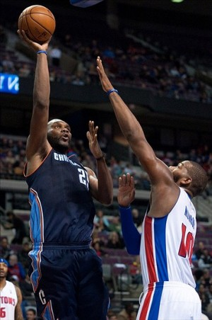 Dec 20, 2013; Auburn Hills, MI, USA; Detroit Pistons power forward Greg Monroe (10) blocks the shot of Charlotte Bobcats center Al Jefferson (25) during the second quarter at The Palace of Auburn Hills. Mandatory Credit: Tim Fuller-USA TODAY Sports