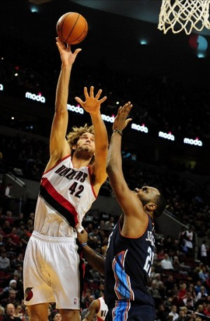 Jan. 02, 2014; Portland, OR, USA; Portland Trail Blazers center Robin Lopez (42) shoots the ball over Charlotte Bobcats center Al Jefferson (25) during the third quarter of the game at the Moda Center. The Blazers won the game 134-104. Mandatory Credit: Steve Dykes-USA TODAY Sports