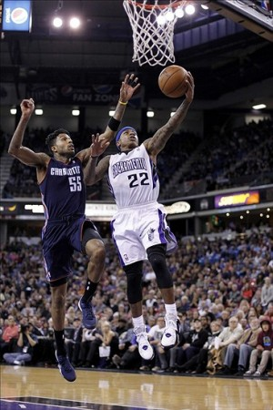 Jan 4, 2014; Sacramento, CA, USA; Sacramento Kings guard Isaiah Thomas (22) attempts a layup in front of Charlotte Bobcats guard Chris Douglas-Roberts (55) in the third quarter at Sleep Train Arena. The Bobcats defeated the Kings 113-103. Mandatory Credit: Cary Edmondson-USA TODAY Sports
