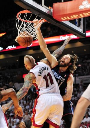 Apr 20, 2014; Miami, FL, USA; Charlotte Bobcats forward Josh McRoberts (11) dunks the ball over Miami Heat forward Chris Andersen (11) during the second half in game one during the first round of the 2014 NBA Playoffs at American Airlines Arena. The Heat won 99-88. Mandatory Credit: Steve Mitchell-USA TODAY Sports