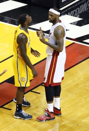 May 30, 2014; Miami, FL, USA; Miami Heat forward LeBron James (right) gestures towards Indiana Pacers guard Lance Stephenson (left) during game six of the Eastern Conference Finals of the 2014 NBA Playoffs at American Airlines Arena. Mandatory Credit: Robert Mayer-USA TODAY Sports