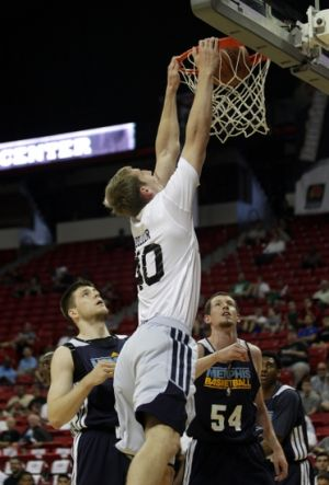 Jul 18, 2013; Las Vegas, NV, USA; Charlotte Bobcats center Cody Zeller dunks the ball above Memphis Grizzlies forward Jack Cooley and forward Matt Howard during an NBA Summer League game at the Thomas and Mack Center. Mandatory Credit: Stephen R. Sylvanie-USA TODAY Sports