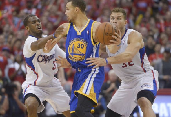 May 3, 2014; Los Angeles, CA, USA; Golden State Warriors guard Stephen Curry (30) is defended by Los Angeles Clippers guard Chris Paul (3) and forward Blake Griffin (32) during game seven of the first round of the 2014 NBA Playoffs at Staples Center. The Clippers defeated the Warriors 126-121 to win the series 4-3. Mandatory Credit: Kirby Lee-USA TODAY Sports