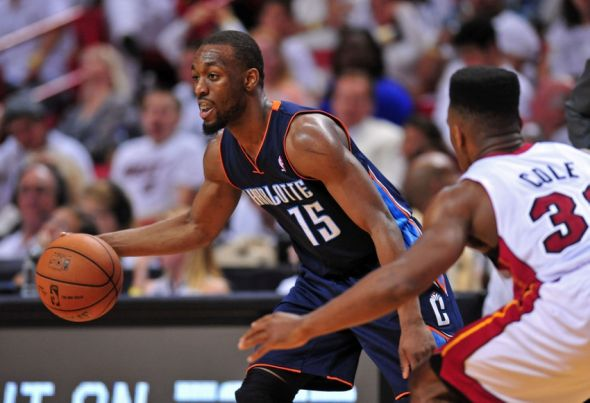 Apr 20, 2014; Miami, FL, USA; Charlotte Bobcats guard Kemba Walker (15) dribbles against Miami Heat guard Norris Cole (30) during the second half in game one during the first round of the 2014 NBA Playoffs at American Airlines Arena. The Heat won 99-88. Mandatory Credit: Steve Mitchell-USA TODAY Sports