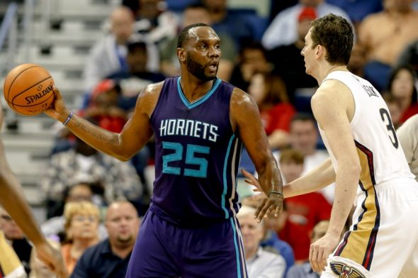 http://cdn.fansided.com/wp-content/blogs.dir/179/files/2014/11/al-jefferson-omer-asik-nba-charlotte-hornets-new-orleans-pelicans-590x900.jpg