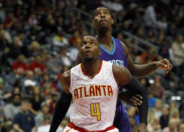 Oct 30, 2015; Atlanta, GA, USA; Atlanta Hawks forward Paul Millsap (4) boxes out Charlotte Hornets forward Marvin Williams (2) in the first quarter at Philips Arena. Mandatory Credit: Brett Davis-USA TODAY Sports