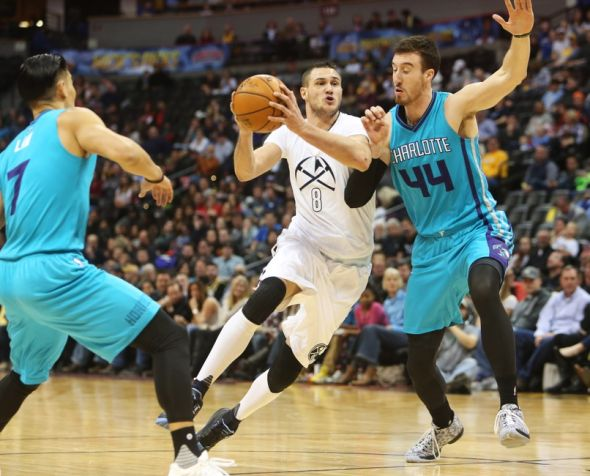 Jan 10, 2016; Denver, CO, USA; Denver Nuggets forward Danilo Gallinari (8) drives to the basket against Charlotte Hornets center Frank Kaminsky III (44) during the first half at Pepsi Center. Mandatory Credit: Chris Humphreys-USA TODAY Sports