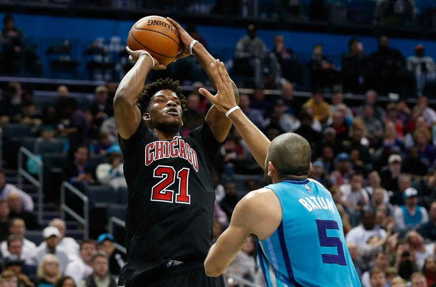 Dec 23, 2016; Charlotte, NC, USA; Chicago Bulls forward Jimmy Butler (21) shoots the ball over Charlotte Hornets guard Nicolas Batum (5) in the second half at Spectrum Center. The Hornets defeated the Bulls 103-91. Mandatory Credit: Jeremy Brevard-USA TODAY Sports