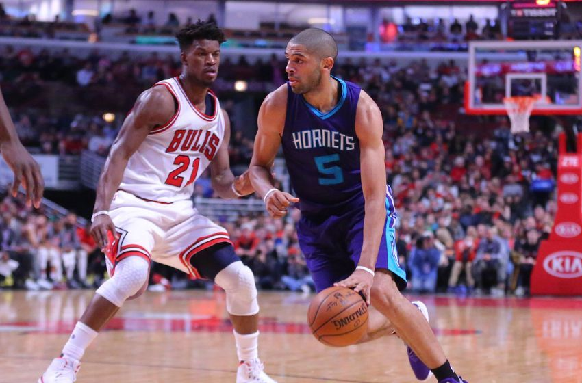 Jan 2, 2017; Chicago, IL, USA; Charlotte Hornets guard Nicolas Batum (5) drives around Chicago Bulls forward Jimmy Butler (21) during the first half at the United Center. Mandatory Credit: Dennis Wierzbicki-USA TODAY Sports