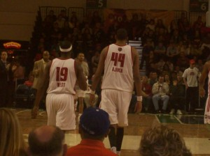 Mario West and Alexis Ajinca Walk off the court following a Red Claws victory over Erie.