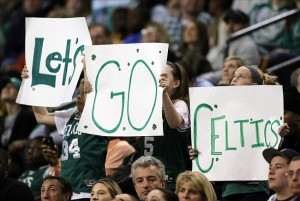 Jan 4, 2013; Boston, Massachusetts, USA; Boston Celtics fans hold up signs during the fourth quarter against the Indiana Pacers at TD Banknorth Garden. The Boston Celtics won 94-75. Mandatory Credit: Greg M. Cooper-USA TODAY Sports