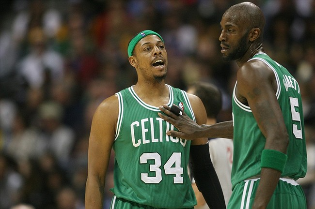 Feb 19, 2013; Denver, CO, USA; Boston Celtics forward Paul Pierce (34) talks with forward Kevin Garnett (5) during the second half against the Denver Nuggets at the Pepsi Center. The Nuggets won 97-90. Mandatory Credit: Chris Humphreys-USA TODAY Sports
