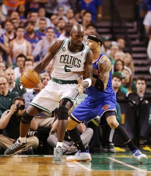 Apr 28, 2013; Boston, MA, USA; Boston Celtics center Kevin Garnett (5) dribbles the all against New York Knicks power forward Kenyon Martin (right) during game four of the first round of the 2013 NBA playoffs at TD Garden. Mandatory Credit: Mark L. Baer-USA TODAY Sports