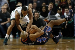 Nov 13, 2013; Boston, MA, USA; Boston Celtics guard Avery Bradley (0) and Charlotte Bobcats guard/forward Gerald Henderson (9) battle for a loose ball during the fourth quarter at TD Garden. The Charlotte Bobcats won 89-83. Mandatory Credit: Greg M. Cooper-USA TODAY Sports