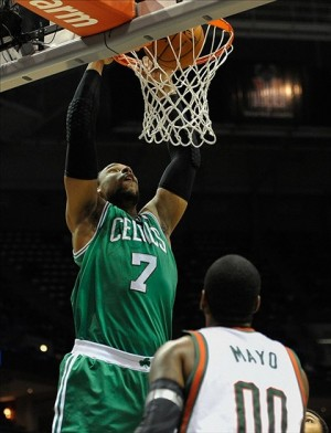 Nov 30, 2013; Milwaukee, WI, USA; Boston Celtics forward Jared Sullinger (7) dunks a basket over Milwaukee Bucks guard O.J. Mayo (00) in the 2nd quarter at BMO Harris Bradley Center. Mandatory Credit: Benny Sieu-USA TODAY Sports