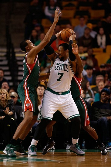 Dec 3, 2013; Boston, MA, USA; Boston Celtics forward/center Jared Sullinger (7) is swarmed by Milwaukee Bucks forward/center John Henson (31) and guard Brandon Knight (behind) during the fourth quarter at TD Garden. The Boston Celtics won 108-100. Mandatory Credit: Greg M. Cooper-USA TODAY Sports