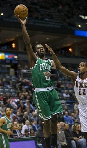Feb 10, 2014; Milwaukee, WI, USA; Boston Celtics forward Jeff Green (8) shoots during the first quarter against the Milwaukee Bucks at BMO Harris Bradley Center. Mandatory Credit: Jeff Hanisch-USA TODAY Sports