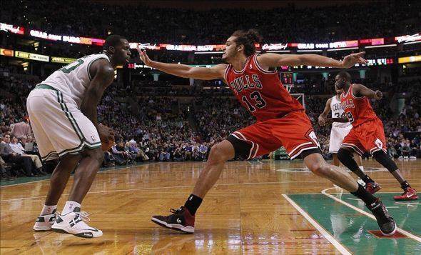 Feb 13, 2013; Boston, Massachusetts, USA; Chicago Bulls forward/center Joakim Noah (13) guards Boston Celtics forward/center Brandon Bass (30) during the third quarter at TD Banknorth Garden. Mandatory Credit: Greg M. Cooper-USA TODAY Sports