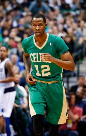 Mar 17, 2014; Dallas, TX, USA; Boston Celtics forward Chris Johnson (12) reacts during the game against the Dallas Mavericks at American Airlines Center. Dallas won 94-89. Mandatory Credit: Kevin Jairaj-USA TODAY Sports