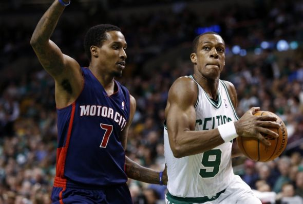 Mar 9, 2014; Boston, MA, USA; Boston Celtics point guard Rajon Rondo (9) drives to the hoop against Detroit Pistons point guard Brandon Jennings (7) during the second half at TD Garden. Mandatory Credit: Mark L. Baer-USA TODAY Sports