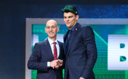 Jun 23, 2016; New York, NY, USA; Ante Zizic greets NBA commissioner Adam Silver after being selected as the number twenty-three overall pick to the Boston Celtics in the first round of the 2016 NBA Draft at Barclays Center. Mandatory Credit: Jerry Lai-USA TODAY Sports
