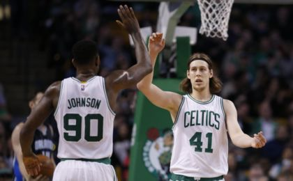 Mar 21, 2016; Boston, MA, USA; Boston Celtics center Kelly Olynyk (41) is congratulated by forward Amir Johnson (90) after a basket during the second quarter against the Orlando Magic at TD Garden. Mandatory Credit: Greg M. Cooper-USA TODAY Sports