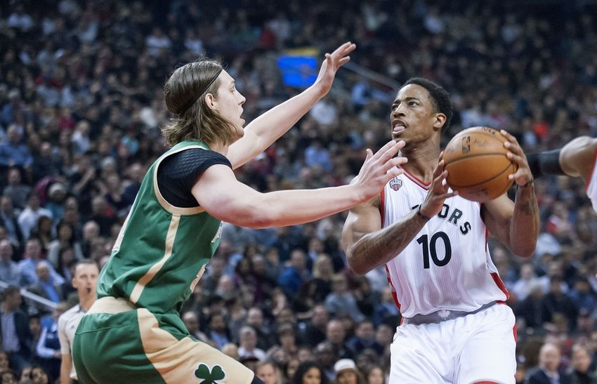 Mar 18, 2016; Toronto, Ontario, CAN; Toronto Raptors guard DeMar DeRozan (10) looks to shoot as Boston Celtics forward Kelly Olynyk (41) defends in the first quarter at Air Canada Centre. Mandatory Credit: Peter Llewellyn-USA TODAY Sports