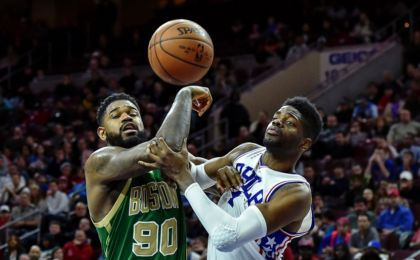 Mar 20, 2016; Philadelphia, PA, USA; Boston Celtics forward Amir Johnson (90) and Philadelphia 76ers forward Nerlens Noel (4) battle under the net during the fourth quarter of the game at the Wells Fargo Center. The Celtics won the game 120-105. Mandatory Credit: John Geliebter-USA TODAY Sports