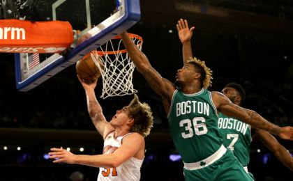 Oct 15, 2016; New York, NY, USA; New York Knicks forward Mindaugas Kuzminskas (91) goes up for a shot against Boston Celtics guard Marcus Smart (36) during the first half at Madison Square Garden. The Celtics won 119-107. Mandatory Credit: Andy Marlin-USA TODAY Sports