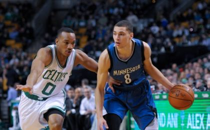 Dec 19, 2014; Boston, MA, USA; Minnesota Timberwolves guard Zach LaVine (8) controls the ball while being defended by Boston Celtics guard Avery Bradley (0) during the first half at TD Garden. Mandatory Credit: Bob DeChiara-USA TODAY Sports