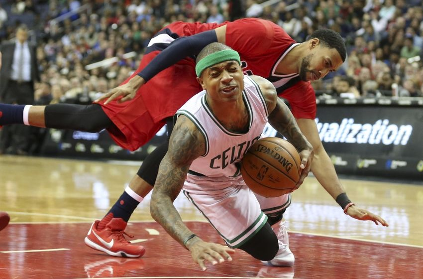 Jan 16, 2016; Washington, DC, USA; Boston Celtics guard Isaiah Thomas (4) fouled by Washington Wizards guard Garrett Temple (17) during the game at Verizon Center. Mandatory Credit: Mitch Stringer-USA TODAY Sports
