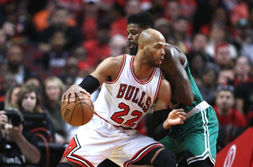 Oct 27, 2016; Chicago, IL, USA; Chicago Bulls forward Taj Gibson (22) makes a move defended by Boston Celtics forward Amir Johnson (90) during the first quarter at the United Center. Mandatory Credit: Dennis Wierzbicki-USA TODAY Sports