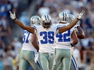 Aug 18, 2012; San Diego, CA, USA; Dallas Cowboys cornerback Brandon Carr (39) celebrates after intercepting a pass in the second quarter against the San Diego Chargers at Qualcomm Stadium. Mandatory Credit: Kirby Lee/Image of Sport-USA TODAY Sports