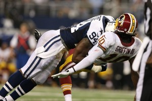 Nov 22, 2012; Arlington, TX, USA; Washington Redskins quarterback Robert Griffin III (10) is hit by Dallas Cowboys linebacker DeMarcus Ware (94) during a game on Thanksgiving at Cowboys Stadium. Mandatory Credit: Matthew Emmons-USA TODAY Sports