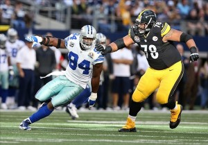 Dec 16, 2012; Arlington, TX, USA; Dallas Cowboys linebacker DeMarcus Ware (94) in action against Pittsburgh Steelers tackle Max Starks (78) at Cowboys Stadium. Mandatory Credit: Matthew Emmons-USA TODAY Sports